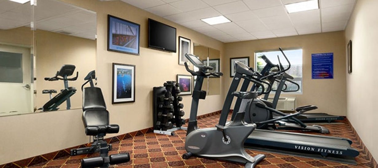 The fitness centre at d3h Days Inn Edmonton South is equipped with treadmills, stationary bicycle, elliptical machine, and a rack of free weights.  The carpeted fitness room also features wide wall mirrors, framed paintings and a wall mounted 42-inch flatscreen TV.