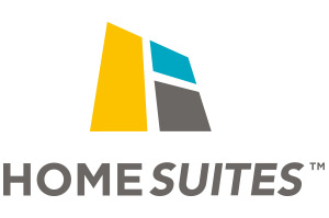 The corporate logo and slogan of Home Suites by d3h is in heavy black typeset contrasted against a white background.  A brown outline of a house, filled in with green color is included as part of the logo design.