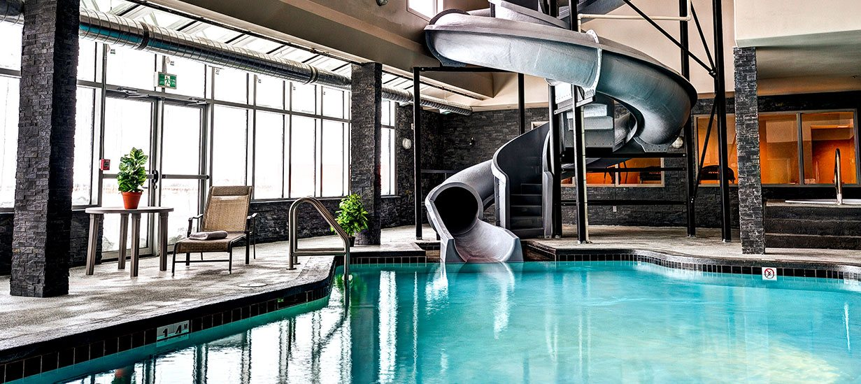 At d3h Home Inn & Suites Swift Current, one of the most popular amenities is a large curving water slide and pool.  Large picture windows let in lots of natural light into the spacious pool area.