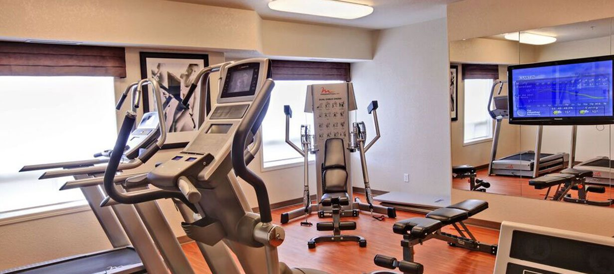 The 24 hour fitness centre at d3h HomeSuites Regina East offers guests access to state of the art exercise equipment such as free-motion treadmills, elliptical machines and stationary bicycles with built-in TV screens.  Other amenities include a weight bench and a flatscreen TV.